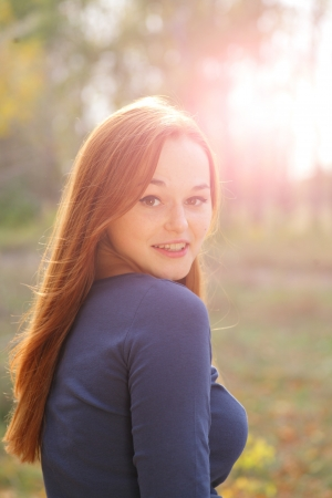 portrait of cute red haired young woman, outdoor, backlit Stock Photo - 15690160