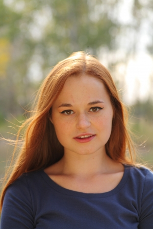 portrait of cute red haired young woman, outdoor Stock Photo - 15690170