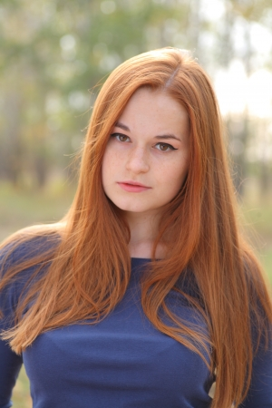 landlady: Natural beautiful red-haired girl head and shoulders shot outdoor