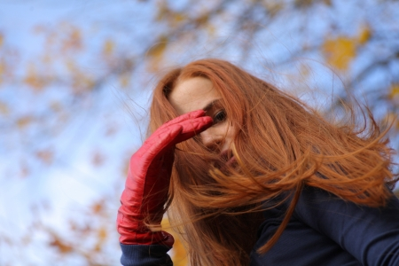 Close-up portrait of a beautiful red-headed girl posing outdoors Stock Photo - 15690183