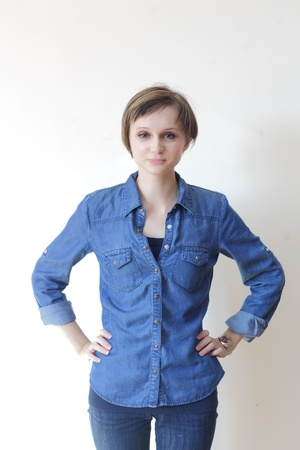 Pretty young blond woman in jeans shirt - copyspace photo