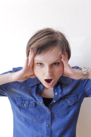 Portrait on  wildly  screaming woman indoors Stock Photo - 15675190