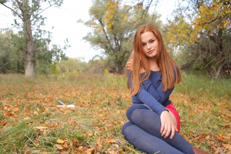 happy young woman outdoors in the field in autumn photo