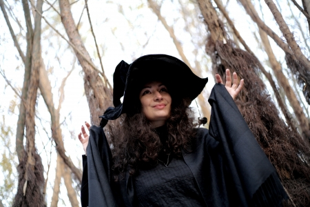 Shot of a gothic woman in a autumn park. Halloween. photo