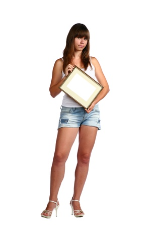 A young pretty woman in jeans shorts  and white top photo