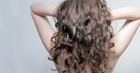 Beautiful female curly red hairs - back view Stock Photo - 16139396