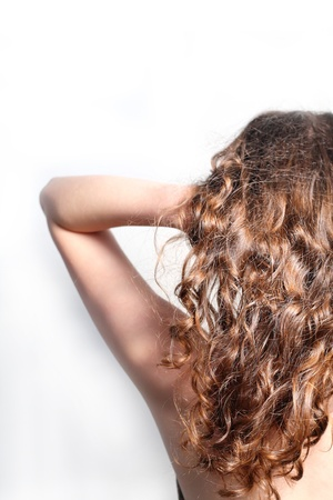 Beautiful female curly red hairs - back view photo