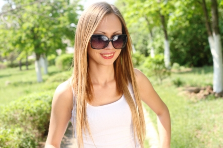 sexiness: Portrait of a beautiful sexy woman outdoors in sunglasses