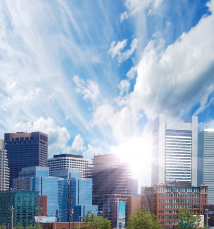 skyline of the city and sunrays  Stock Photo