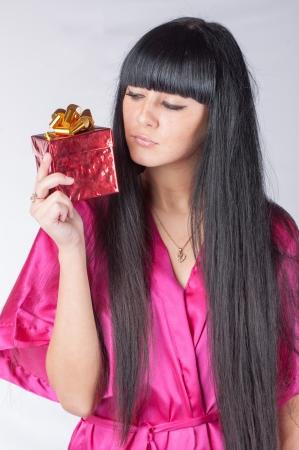 brunette with giftbox studio shot photo