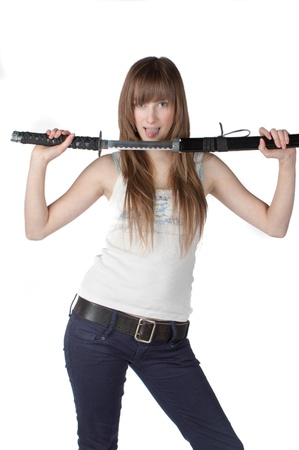 Beautiful blonde lady with japanese sword isolated photo