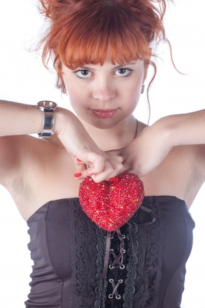 Portrait of beautiful redhead caucasian girl with heart in hand. Stock Photo - 17395891