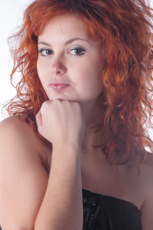 Portrait of beautiful young woman with red hair closeup on white. Fist photo