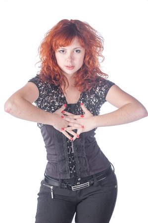portrait beauty young redheaded girl in black over white photo