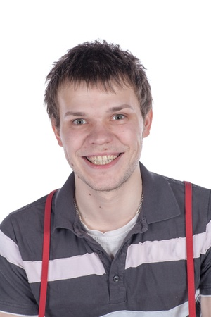 Young man looking very happy over light background photo