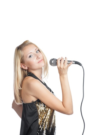 blonde woman holding a retro microphone on white background photo
