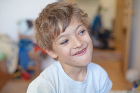 Portrait of handsome young boy making funny face  photo
