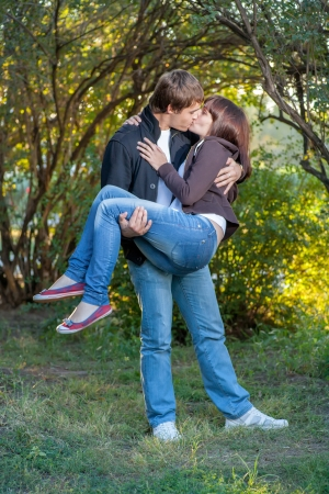 Young happy attractive couple kissing, outdoors Stock Photo - 17758514