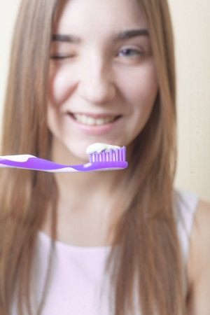Dental Hygiene Concept - A close-up view of a blond woman with teeth brush photo