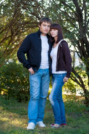 Young Couple of College Students outdors embracing photo