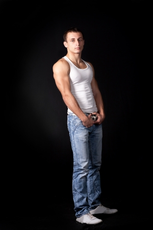 Handsome muscle men athlete on a black background photo