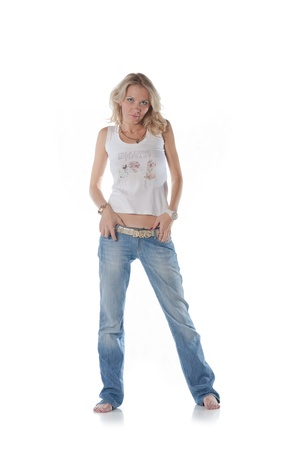 pretty blond women on white background Weared in jeans and white shirt