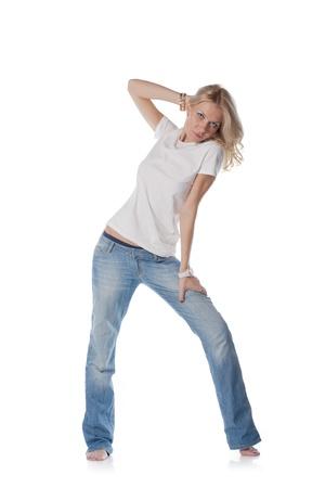 pretty blond women dancing on white background photo