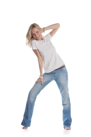20 24 years old: pretty blond women dancing on white background Stock Photo