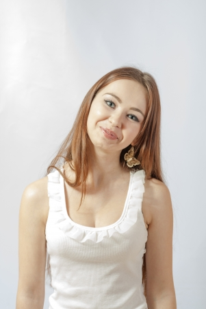 Beautiful young smiling woman  Isolated over white background photo
