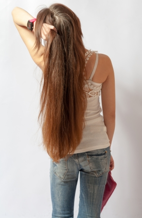long pants: Girl with long fair hair from back, on white background