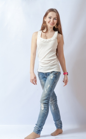 20 24 years old: Full length portrait of a caucasian blond woman on gray background Stock Photo