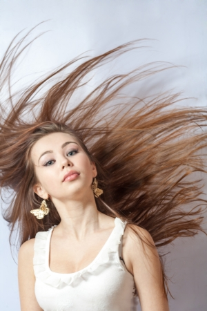 portrait of a beautiful blonde girl with hair fluttering in the wind photo