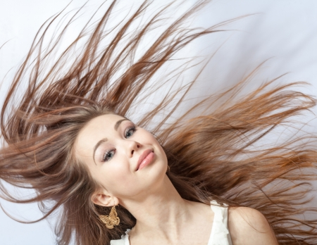Pretty girl with great fly-away hair  Over white background Stock Photo - 18260361