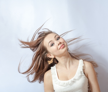 Pretty girl with great fly-away hair  Over white background photo