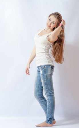 no heels: Full length portrait of a caucasian blond woman on gray background Stock Photo