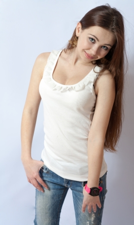 no shirt: Portrait of a pretty, smiling blonde in jeans on white  20-24 years old young women in studio front view Stock Photo