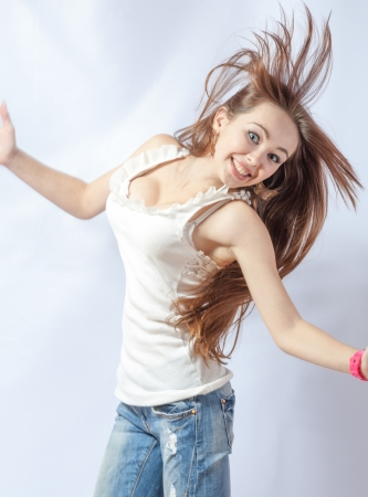 Pretty 20-24 years old blonde girl with great fly-away hair on white background Stock Photo - 18260548