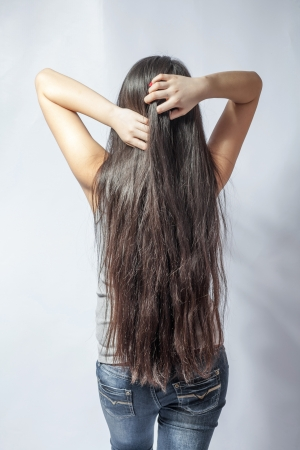 korean fashion: Girl with long fair hair from back, on white background