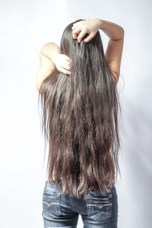 back straight: Girl with long fair hair from back, on white background