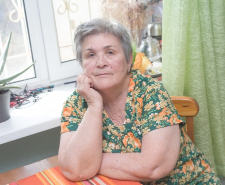 Portrait of a senior woman indoors thinking Stock Photo - 18381316