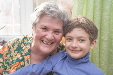 Portrait of a happy little boy and his grandmothers