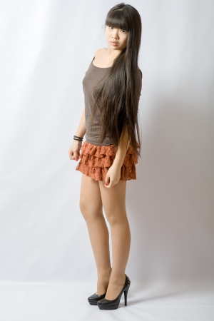 Young asian student  Beautiful young woman  Portrait of asian woman in brown skirt photo