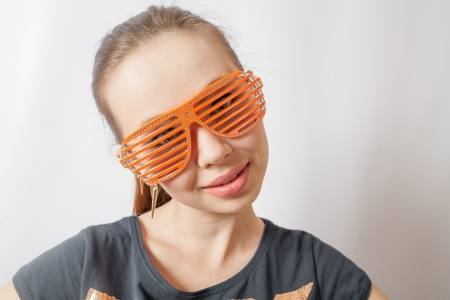 portrait of a beautiful young sexy woman wearing party sunglasses  Smiling face, having fun photo