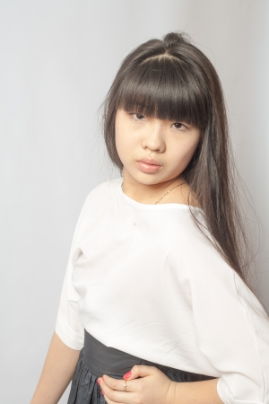 Portrait of asian woman  Casual woman portrait of young smiling girl with long black hair and clean skin over white photo