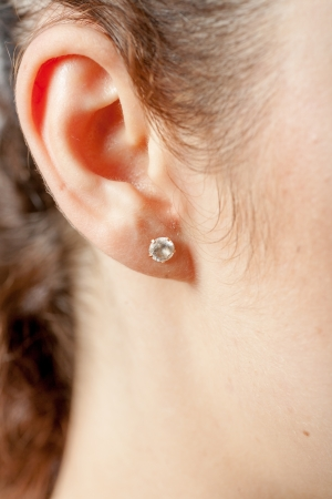 Young caucasian woman ear closeup  photo