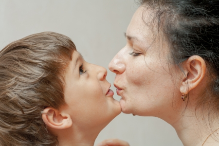 Happiness of mother and little son  Kissing photo