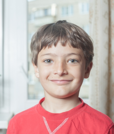 Portrait of an adorable young boy indoors in red shirt photo
