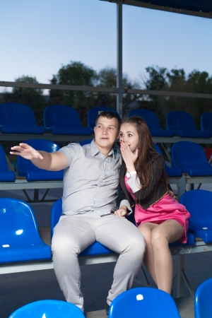 17 20: Happy fans couple watching their favorite sport team  Boy pinting