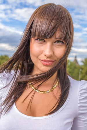 Outdoors street portrait of beautiful young brunette girl Stock Photo - 19699060