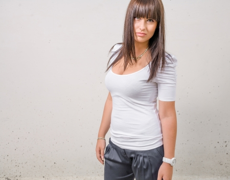 hot young brunette girl in front of white wall horizontal shot photo